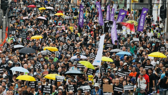 Protesters march in Hong Kong on Sunday, October 1, 2017.