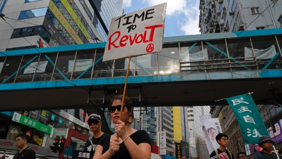 Protesters march in Hong Kong Sunday, Oct. 1, 2017. Pro-democracy groups held a protest against what they perceive as China