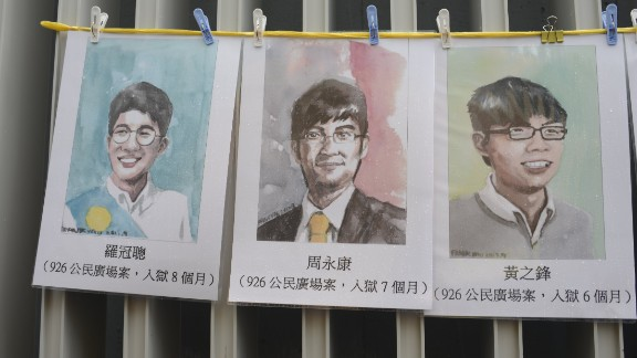 Portraits of three jailed Hong Kong pro-democracy activists -- Nathan Law, Alex Chow and Joshua Wong -- seen at a protest march on October 1, 2017.