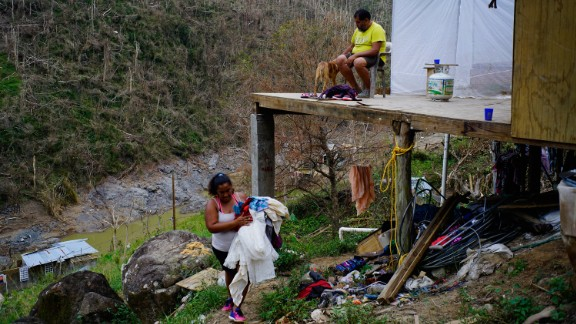 "Yadira Sortre and William Fontan Quintero clean their house, destroyed by Hurricane Maria in in Moravis, Puerto Rico, Sunday, Oct. 1, 2017. ""We lost everything."" Fontan said. They have three children, one lives in Chicago and two live with them in Puerto Rico."