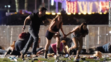 People run from the Route 91 Harvest country music festival after gun fire was heard on October 1, 2017 in Las Vegas, Nevada.