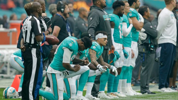 Miami Dolphins players kneel during the National Anthem before playing the New Orleans Saints at Wembley Stadium on October 1 in London.