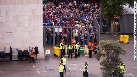 Spectators queued to access the Camp Nou stadium ahead of the match, which was ultimately played with empty stands after violence erupted at polling stations.