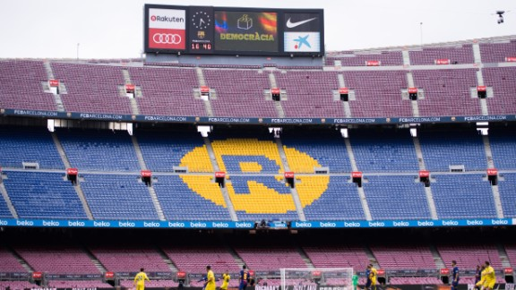 The word 'Democracia', Catalan for 'Democracy', is displayed in the Camp Nou stadium board during FC Barcelona's match.