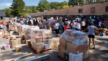 "Volunteers for ""Puerto Ricovery"" sort and pack the donated supplies before they are loaded into containers for shipment to the island."