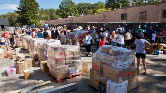 """Volunteers for """"Puerto Ricovery"""" sort and pack the donated supplies before they are loaded into containers for shipment to the island."""