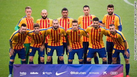 FC Barcelona pose for a team photo wearing shirts in the colors of the Catalan flag prior to kickoff. The team played the match in its traditional home jersey.