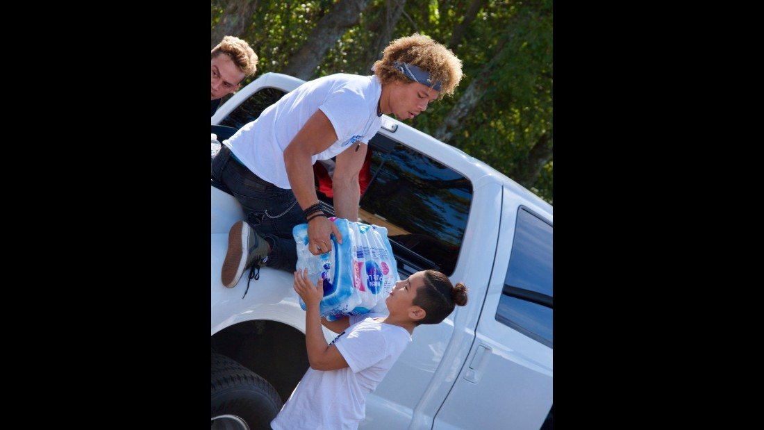 "Volunteers offload donated supplies at the ""Puerto Ricovery"" donation drive."