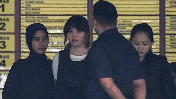 Royal Malaysian Police escort Vietnamese defendant Doan Thi Huong (2nd L) after her trial at the Shah Alam High Court in Shah Alam, outside Kuala Lumpur on October 2, 2017, for her alleged role in the assassination of Kim Jong-Nam, the half-brother of North Korean leader Kim Jong-Un.