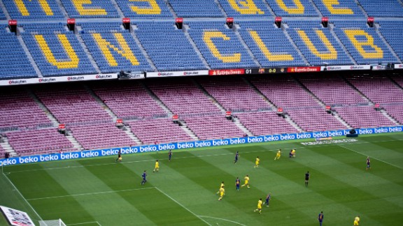 "Barcelona's game against Las Palmas was played in an empty stadium, with the club's slogan -- ""more than a club"" -- clearly visible on the seats."