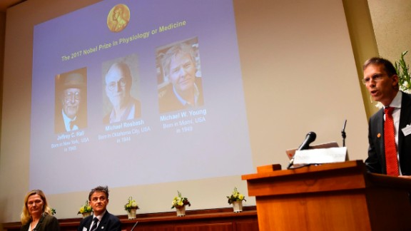 Secretary of the Nobel Committee for Physiology or Medicine, Thomas Perlmann (R), announces the winners of the 2017 Nobel Prize.