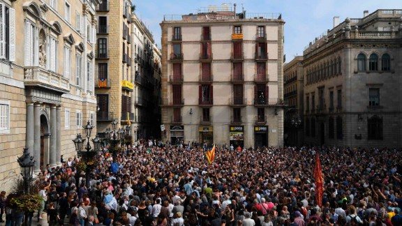 People attend a protest in Barcelona on Monday, October 2, a day after hundreds were injured in a police crackdown during the banned referendum. The Catalan government claimed victory after pushing forward with the vote despite Spain's Constitutional Court declaring it illegal.