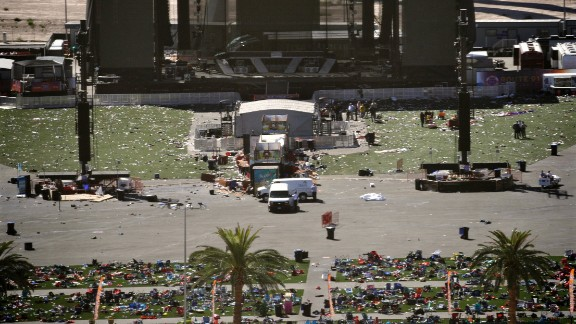 Debris is scattered on the ground Monday, October 2, at the site of a country music festival held this past weekend in Las Vegas. Dozens of people were killed and hundreds were injured Sunday when a gunman opened fire on the crowd. Police said the gunman fired from the Mandalay Bay hotel, several hundred feet southwest of the concert grounds. It is the deadliest mass shooting in modern US history.