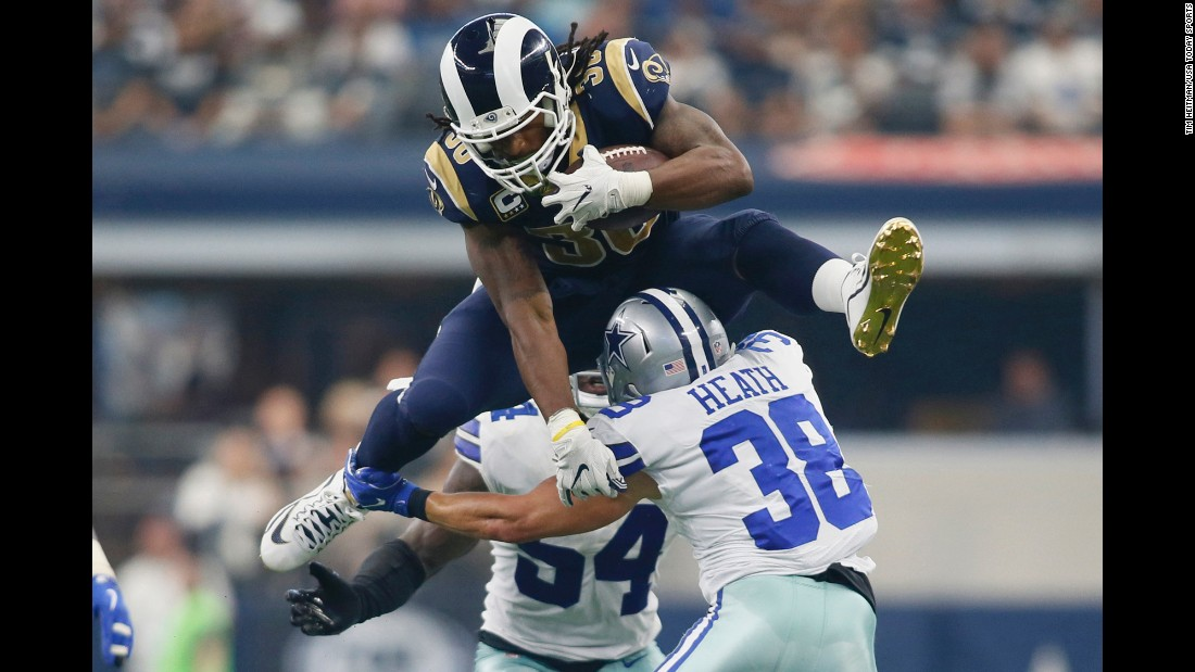 Los Angeles Rams running back Todd Gurley hurdles Dallas safety Jeff Heath during an NFL game in Arlington, Texas, on Sunday, October 1. Gurley had more than 200 yards of offense as the Rams won 35-30.