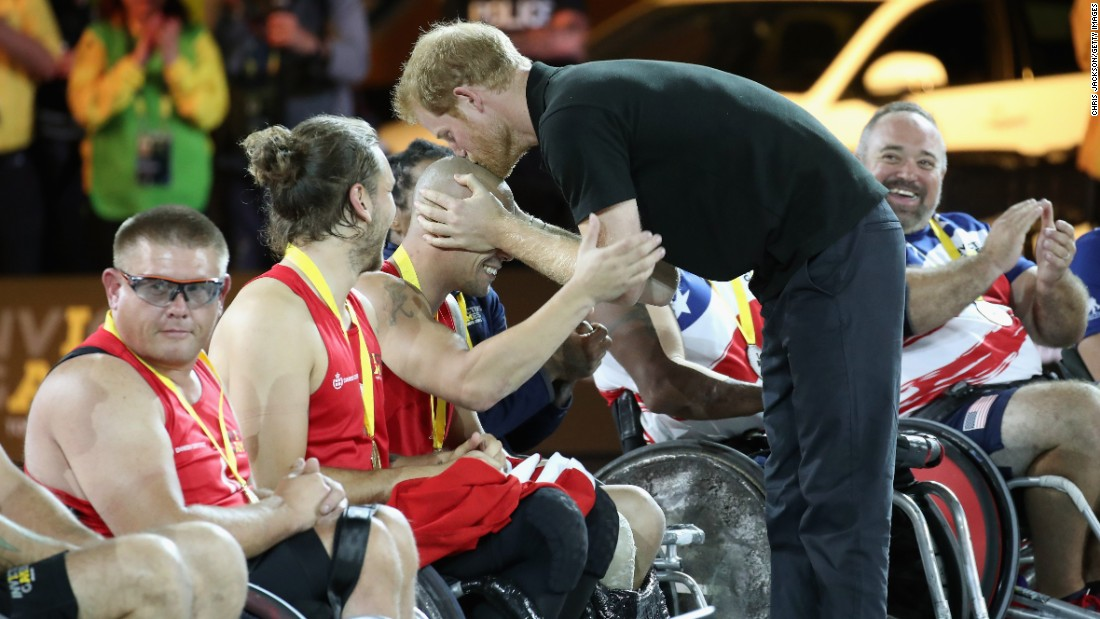 Britain's Prince Harry plants a kiss on Danish athlete Maurice Manuel after presenting him with a gold medal at the Invictus Games in Toronto on Thursday, September 28. Manuel is the captain of Denmark's wheelchair rugby team.