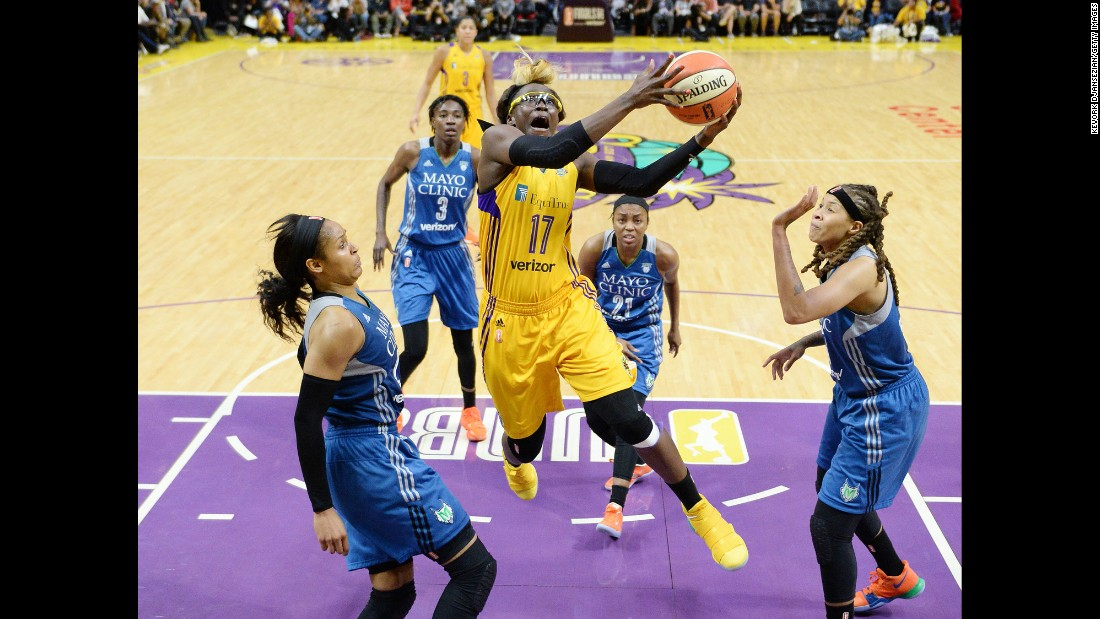 Essence Carson drives to the basket for Los Angeles during Game 4 of the WNBA Finals on Sunday, October 1. Minnesota won the game to force a decisive Game 5, which will take place on Wednesday.