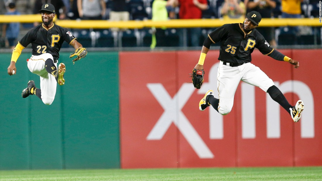Pittsburgh outfielders Andrew McCutchen, left, and Gregory Polanco leap in celebration after a home win over Baltimore on Wednesday, September 27.