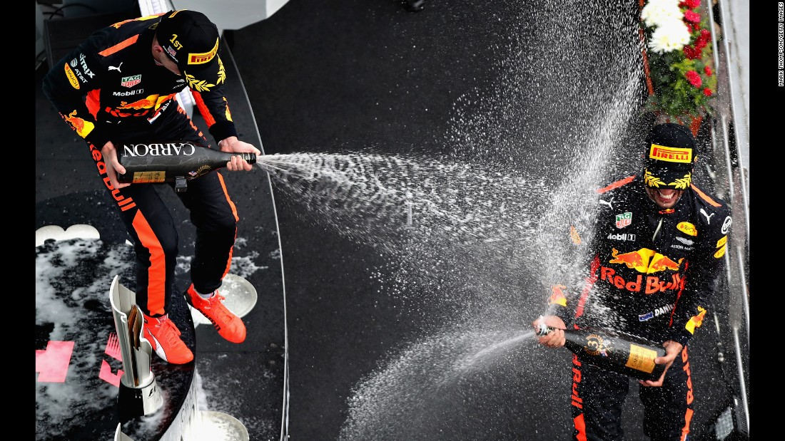 "Formula One driver Max Verstappen, left, sprays his Red Bull teammate, Daniel Ricciardo, after <a href=""http://www.cnn.com/2017/10/01/motorsport/malaysian-gp-verstappen-hamilton-vettel/index.html"" target=""_blank"">winning the Malaysian Grand Prix</a> on Sunday, October 1. It was Verstappen's first win of the season. Ricciardo finished in third."