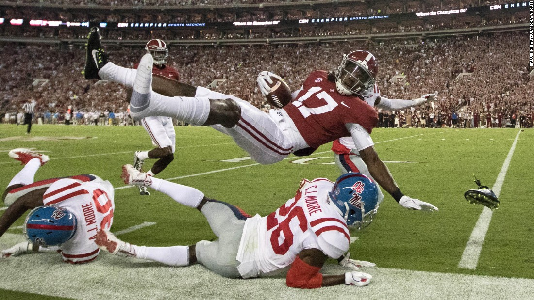 Alabama wide receiver Cam Sims goes flying -- and loses a shoe -- after being knocked out of bounds by Mississippi defensive back C.J. Moore on Saturday, September 30.