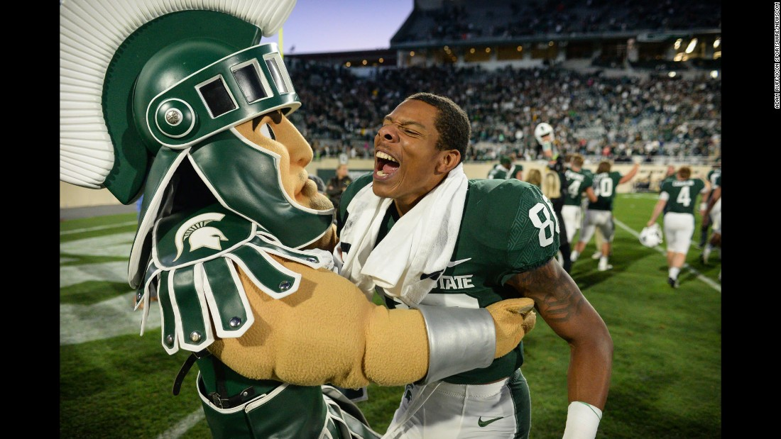 Michigan State wide receiver Trishton Jackson celebrates with Sparty the mascot after a 17-10 home victory over Iowa on Saturday, September 30.