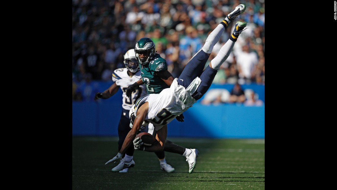 Los Angeles Chargers wide receiver Tyrell Williams lands after leaping over a Philadelphia linebacker on Sunday, October 1.