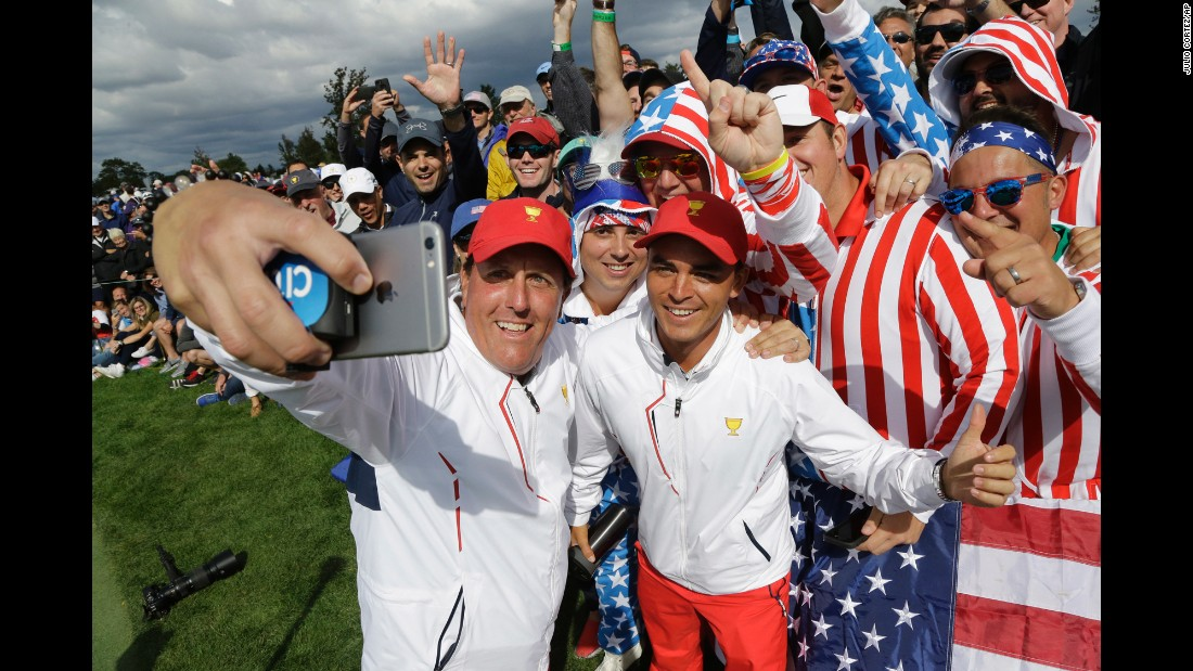 "Golfer Phil Mickelson takes a selfie with fans and teammate Rickie Fowler during Presidents Cup play on Saturday, September 30. The American team continues to dominate the competition, <a href=""http://www.cnn.com/2017/10/02/golf/dustin-johnson-presidents-cup-ryder-cup-phil-mickelson-steve-stricker-trump/index.html"" target=""_blank"">winning it this weekend</a> for the seventh straight time. The International Team has only won the Presidents Cup once -- in 1998."