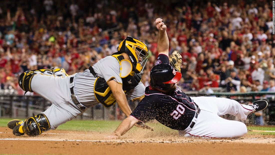 Pittsburgh catcher Elias Diaz tags out Washington's Daniel Murphy during a play at the plate on Friday, September 29.