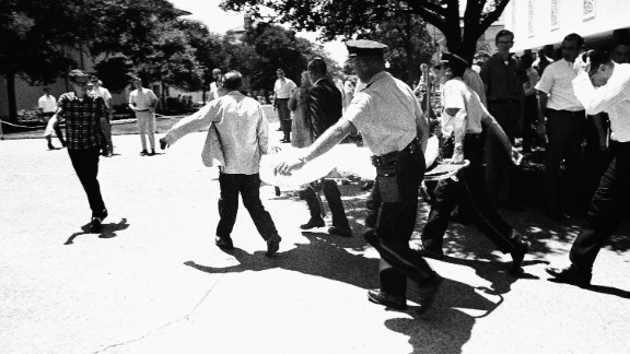 A Whitman victim is carried across the campus to a waiting ambulance in Austin.