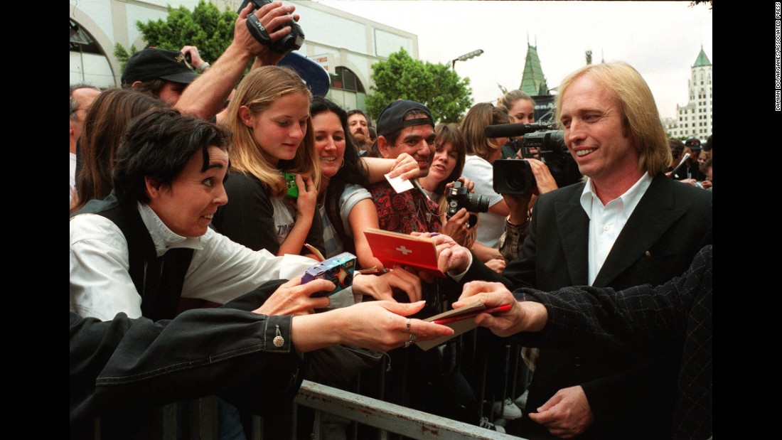 Petty signs autographs after his band got a star on the Hollywood Walk of Fame in April 1999.