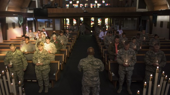 Families and airmen at Nellis Air Force Base gathered to hold vigil for the victims of the Las Vegas shooting