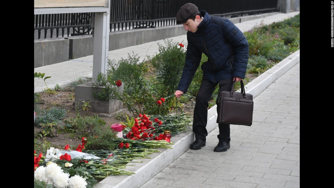 A man leaves flowers outside the US Embassy in Moscow on October 3.