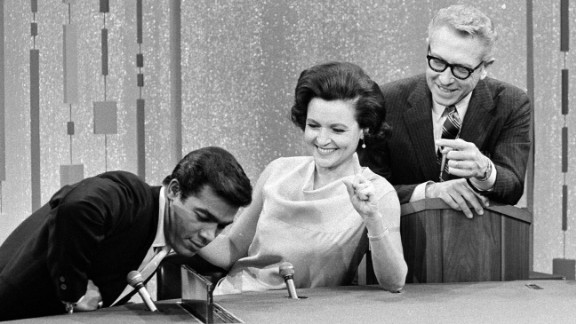 "White appears as a celebrity guest on the game show ""Password"" in 1967. The actress was married to ""Password"" host Allen Ludden, right, from 1963 until his death in 1981."