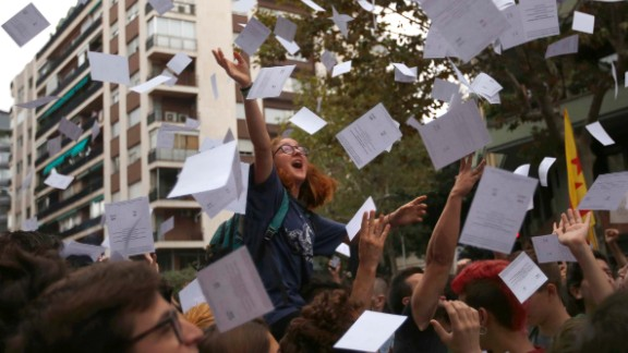 Protestors throw referendum ballots as they rally in front of Spain