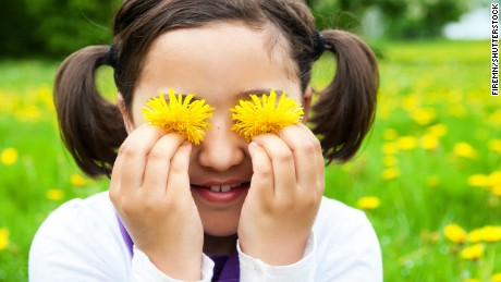 Cute child with Dandelion flowers in spring meadow. Child playing outdoors. Girl is happy outside and having fun.; Shutterstock ID 281486129; Job: -