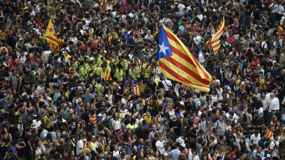 Protesters wave a Catalan pro-independence