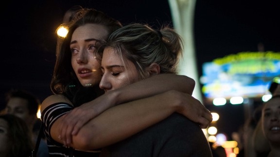 Mourners attend a candlelight vigil for the victims of the mass shooting, October 2, 2017 in Las Vegas, Nevada.