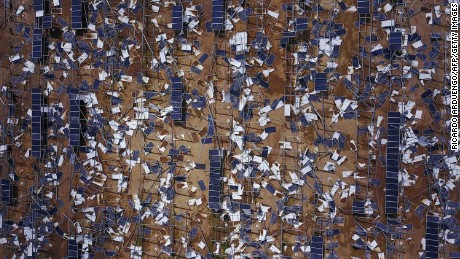 Solar panel debris is seen scattered in a solar panel field in the aftermath of Hurricane Maria in Humacao, Puerto Rico on October 2, 2017.