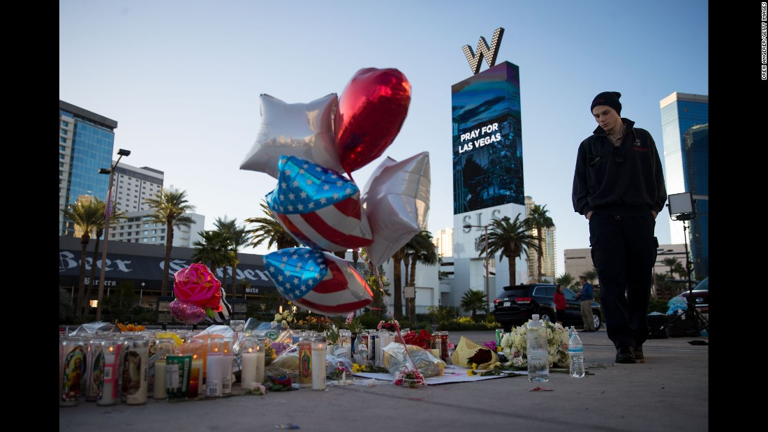 "Matthew Helms visits a makeshift memorial Tuesday, October 3, for the victims of <a href=""http://www.cnn.com/2017/10/02/us/gallery/las-vegas-shooting/index.html"" target=""_blank"">Sunday night's mass shooting in Las Vegas.</a> Helms worked as a medic during the shooting, which was the deadliest in modern US history."