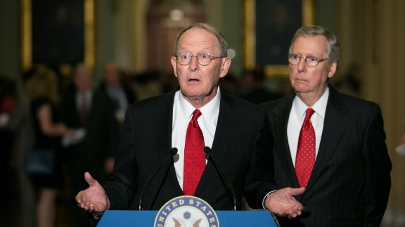 WASHINGTON, DC - JULY 9:  Senate Minority Leader Mitch McConnell (R-KY) (R) and U.S. Sen. Lamar Alexander (R-TN) give a press conference after meeting with fellow Republican Senators on Capitol Hill, July 9, 2013 in Washington, DC. The senators fielded questions about student loan legislation. (Photo by Drew Angerer/Getty Images)