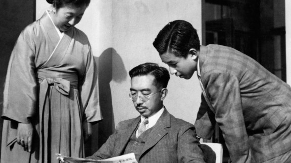 Akihito peers over the shoulder of his father, Emperor Hirohito.