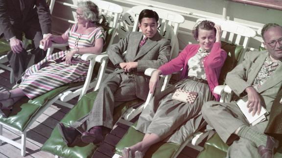 During a seven-month trip in 1953, Akihito sits on the promenade deck of a cruise ship headed from Hawaii to San Francisco. He visited 14 countries.