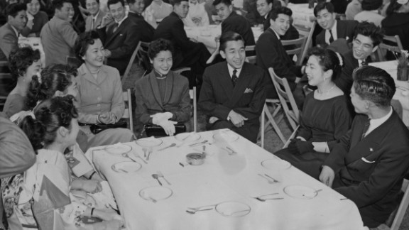 After graduating from Gakushuin University, Akihito attends a farewell party with other graduates in April 1956.