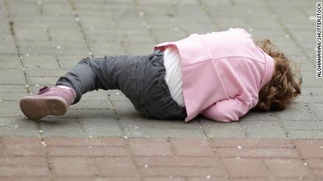 alone crying girl lying on asphalt; Shutterstock ID 222671212; Job: -