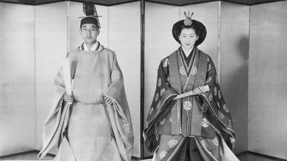 Akihito and Michiko pose in traditional Japanese wedding costumes before their marriage in April 1959.