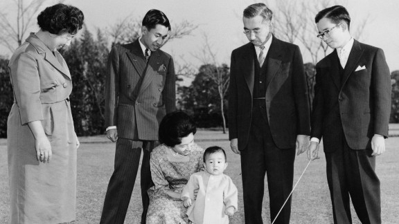 Members of the Japanese imperial family are photographed in 1961. Akihito is second from left, looking at his wife and their first son, Naruhito. They are joined by Akihito