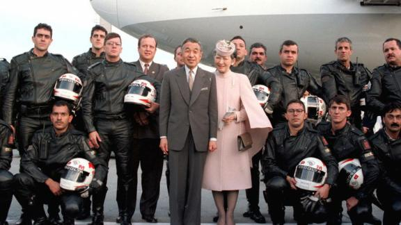 Akihito and Michiko pose with police officers who had escorted them at Brazil
