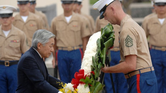 During a visit to Honolulu in 2009, Akihito lays a wreath at the National Memorial Cemetery of the Pacific. Akihito has repeatedly expressed remorse for his country
