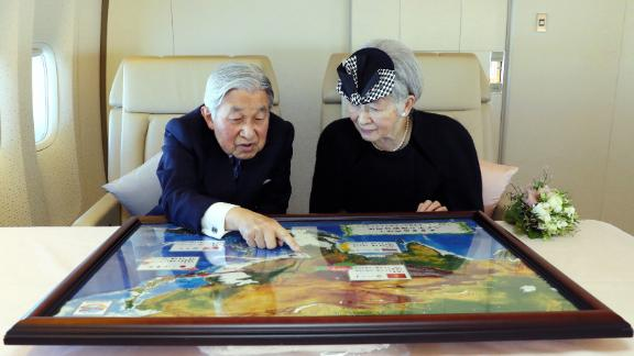Akihito and Michiko sit together during a flight to Vietnam in February 2017.