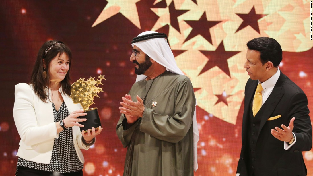 Canadian teacher Maggie MacDonnell receives the Global Teacher Prize from Sheikh Mohammed bin Rashid al-Maktoum,  Vice President and Prime Minister of the United Arab Emirates and ruler of Dubai, during a ceremony in Dubai in March 2017. MacDonnell, who works in a fly-in only village in the Arctic, was among 10 finalists chosen from 179 countries and won a $1 million prize.
