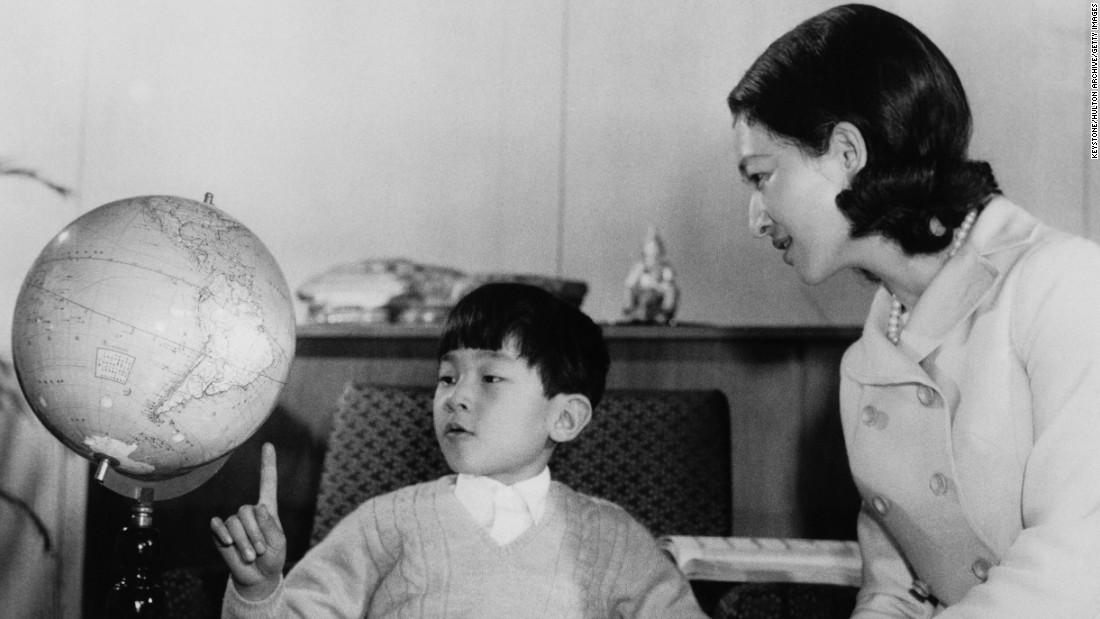 Prince Hiro, also known as Crown Prince Naruhito of Japan, studies a globe with his mother, Empress Michiko, at Togu Palace in Tokyo in February 1968.